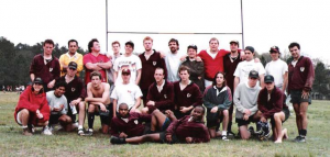rugby team posing on pitch