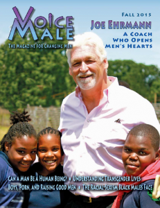 Joe Ehrmann (white) and three children (black) outdoors, smiling and facing the camera.