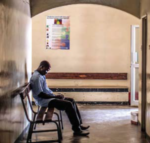 A man waits inside an HIV testing centre in Zambia