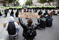 Protesters in Whitehall facing lines of police officers in central London after a demonstration to show solidarity with the Black Lives Matter movement.