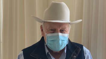 Former vice president Dick Cheney wearing a mask