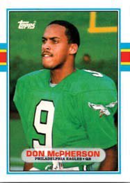 A young man wearing a green football jersey.