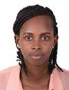 Headshot of woman wearing a pink shirt.