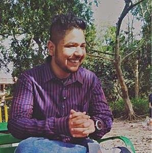 man sitting on a bench outdoors smiling