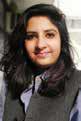 Headshot of woman wearing gray vest