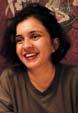 Headshot of a woman with medium-length black hair.