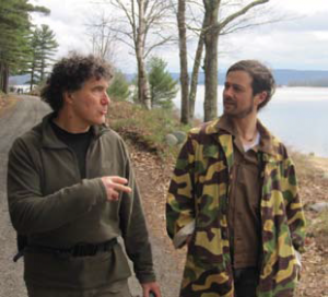 Robbie Leppzer, left, and Josh Latour talk about men's groups then and now while hiking along the banks of the Quabbin Reservoir in western Massachusetts.