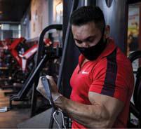 Sardar Ismail, an Iraqi Kurdish bodybuilding world champion, trains at a gym in a mask.