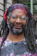Man with locs waring glasses.
