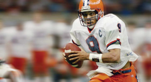 A football player wearing a orange and white jersey.