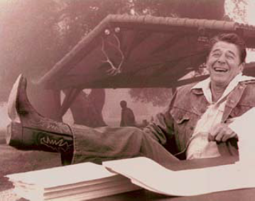Photo of Ronald Reeagan wearing cowboy boots and reclining