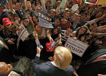 Supporters of Donald Trump holding up signs at an event