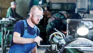 man using an industrial machine