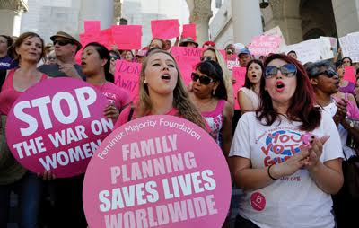 """Planned Parenthood supporters rally for women's access to reproductive health of synchronized care on """"National Pink Out Day'' at Los Angeles City Hall."""