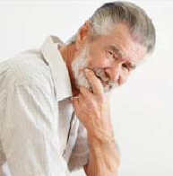 Photo of a bearded, white middle-aged man thinking and looking at the camera.
