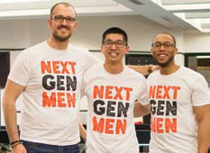 Three men indoors wearing white t-shirts which read 'Next Gen Men'