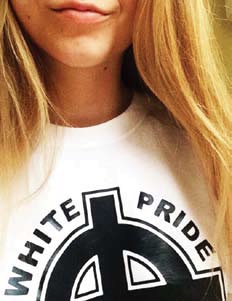 "Photo of a woman wearing a shirt which says ""White Pride"""