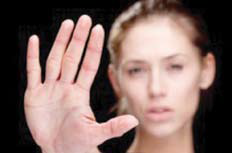 "A woman holding up her hand to the camera to say ""No"""