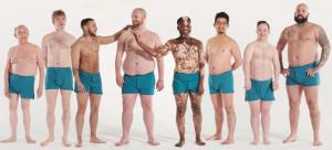 Eight men wearing blue briefs.
