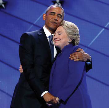 obama and clinton embracing on stage