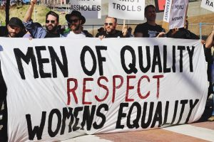 Group pf men at the Women's March holding a sign reading 'Men of Quality Respect Women's Equality'