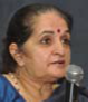 headshot of Rashme Sehgal speaking at a microphone