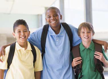 three schoolboys wearing backpacks