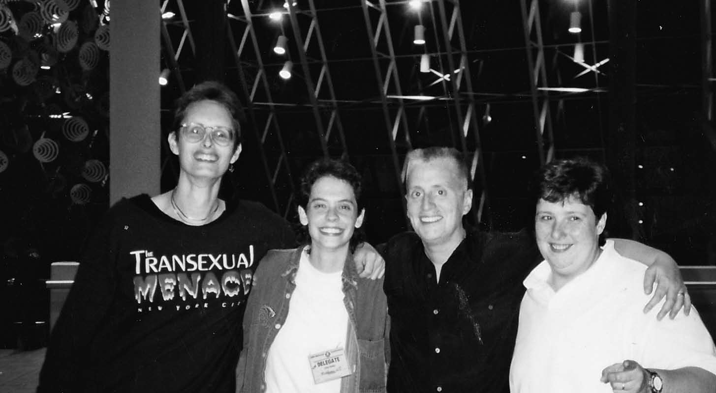Author Riki Wilchins (left), Gina Reiss, Leslie Feinberg, and Wendy Berger at NOW Convention after their successful Trans-Inclusion campaign.